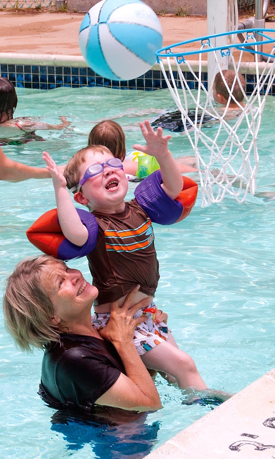 Aiden playing basketball in the pool