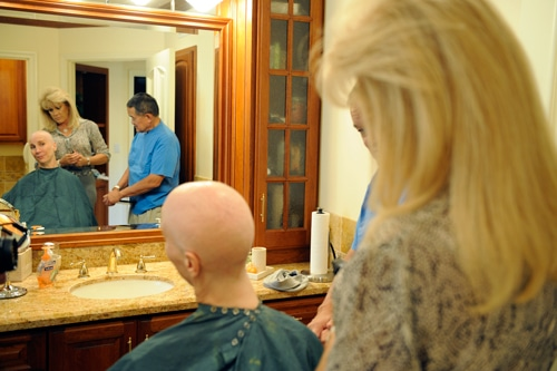 joni in front of a mirror during cancer treatment