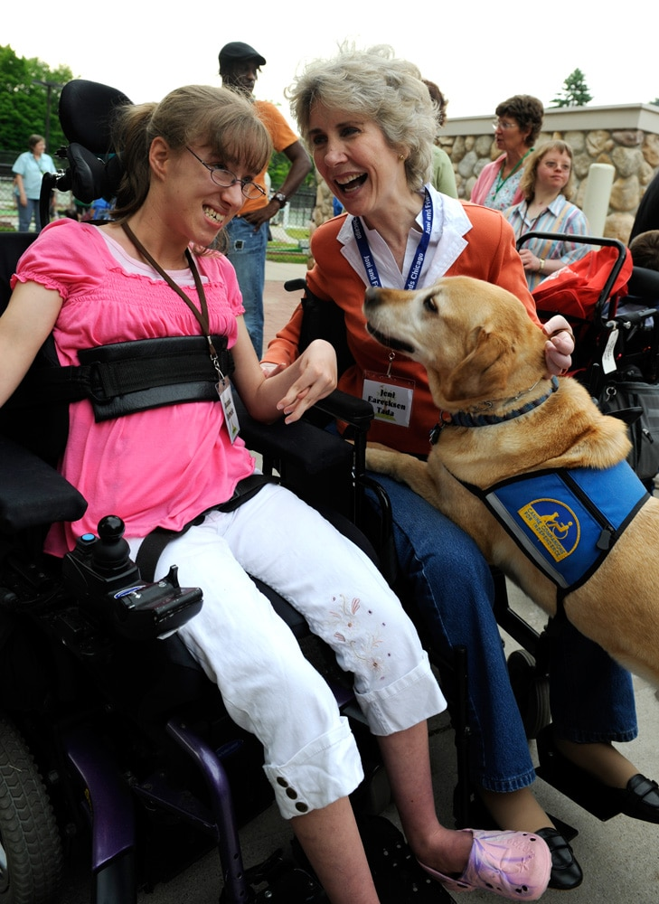 joni with a service dog at a family retreat