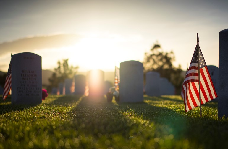 Dawn breaks over the Idaho State Veterans Cemetery in Boise, Idaho, on Memorial Day, May 26, 2014
