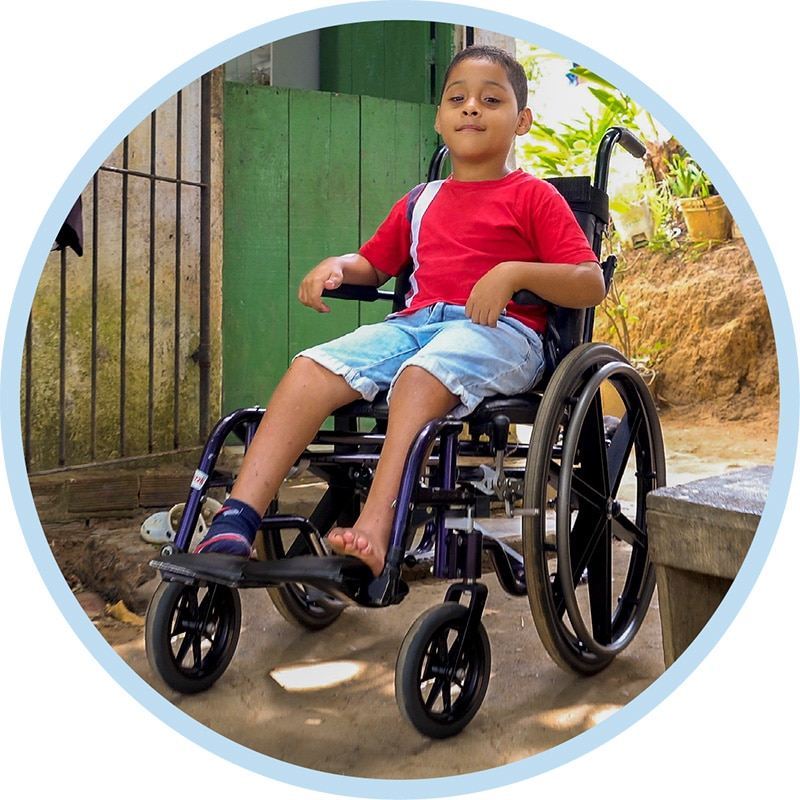 Miguel in his new wheelchair
